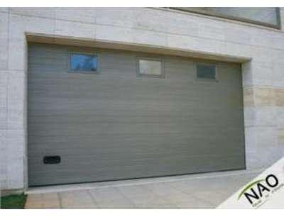 Porte de garage a rainures
