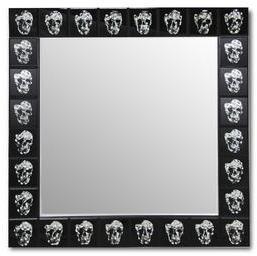Miroir mural avec motif tête