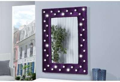 Miroir mural design capitonné